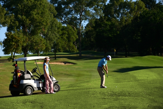 Players_on_course_with_buggy_(7037379563)